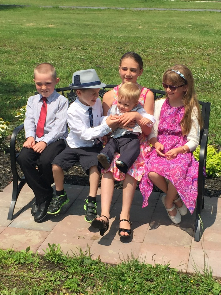 Colton, Aiden, Sage with Jasper and Abby at the Christening.