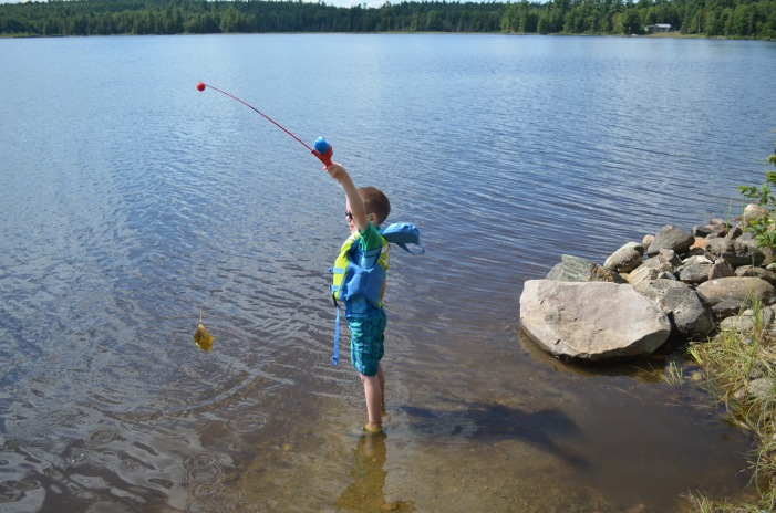 Aiden catching his fish