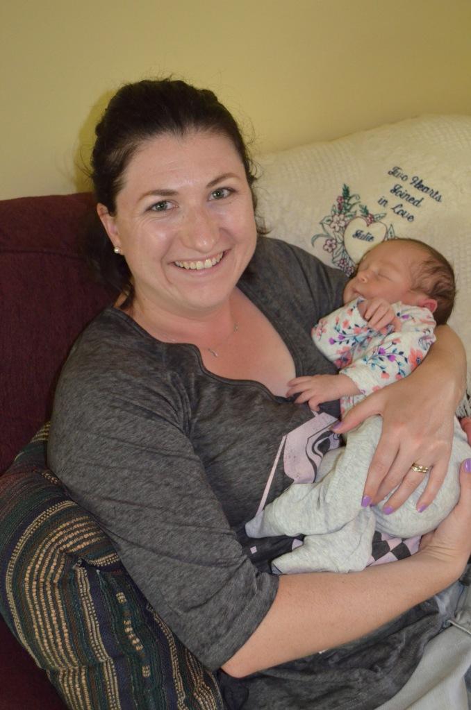 Melissa holding Eva