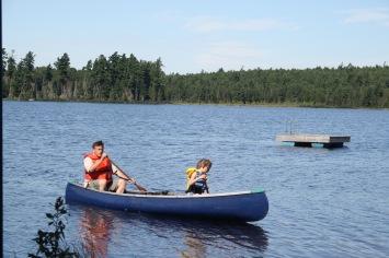 Steven taking Abby for a canoe ride.
