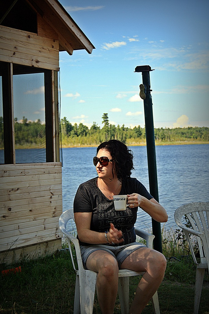 Melissa having an early morning coffee by the river.