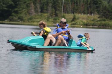 Abby and Aiden fishing with Dad on the paddle boat.