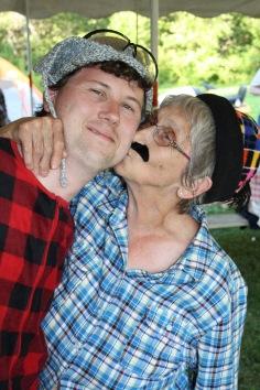 Lumberjack Joyce planting a huge kiss on Lumberjack Shawn
