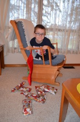 Aiden in front of his Stocking