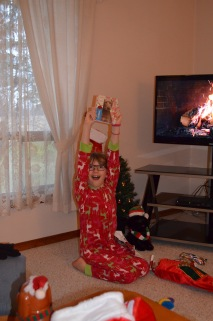 Abby holding up the journal she got from Santa