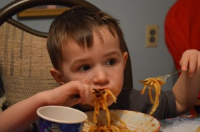 Macklan devouring his spaghetti at supper :)