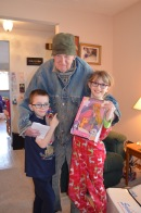 Abby and Aiden with their Great Uncle Joe holding the gifts he got for them.