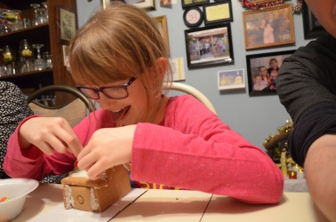 Abby decorating her gingerbread house