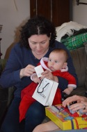 Eva helping Melissa open her present from Peter