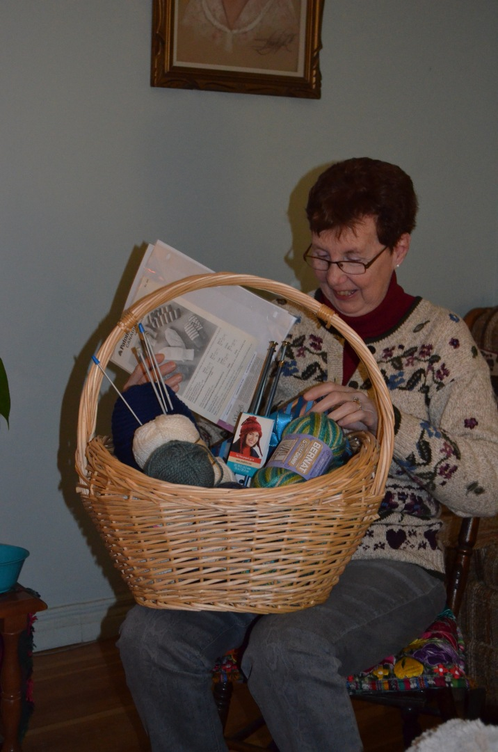 Jackie checking out her new knitting basket and supplies.
