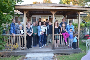 Front (L-R): Rob, Betty, Mom Linda, Melissa with Eva, Susan, Mark, Julie, Abby, Jane, Aiden, Macklan. Back (L-R): Bob, Peter, Jason, Peter's Uncle & Aunt, Susa, Peter, Dad & Craig