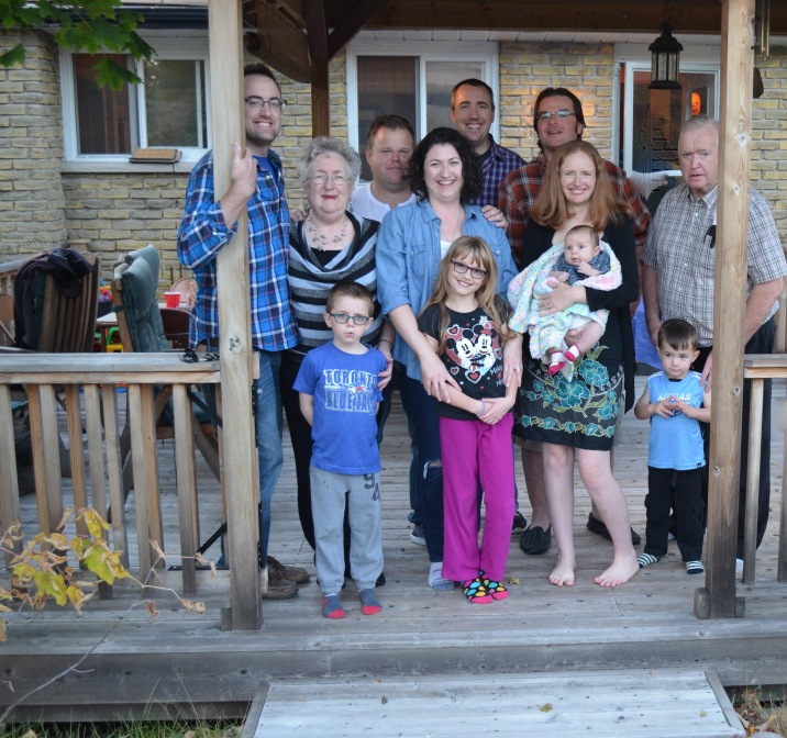 Back (L-R): Rob, Mom, Jason, Peter C, Peter A., Dad Front (L-R): Aiden, Meliss, Abby, Julie with Eva, Macklan
