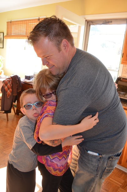 Uncle Jason giving Abby and Aiden a big hug.