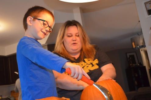 Aiden and Megan carving the pumpkin