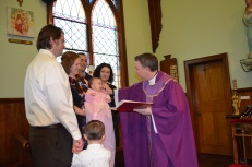 Father Cruikshank blessing Eva