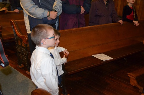 Aiden and Macklan supervising the Baptism