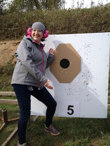 Melissa showing of her target shooting