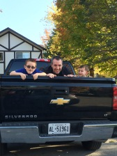 Aiden, Peter & Macklan playing in the back of the rental truck.