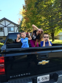 Macklan, Abby and Aiden having fun in the back of the Rental truck