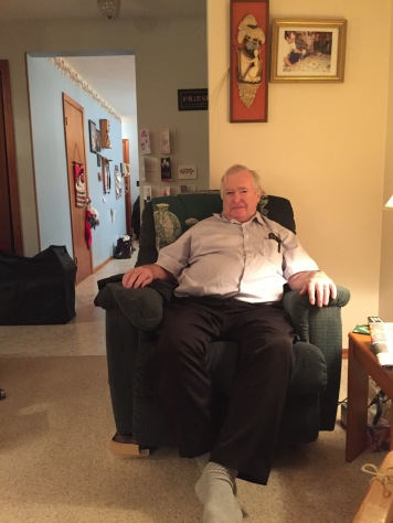 Dad resting on his chair on Christmas Eve.