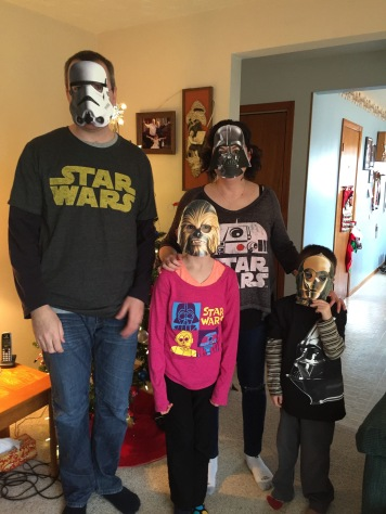Storm Trooper Peter, Darth Melissa, Chewey Abby and C-3PO Aiden ready for the movie.