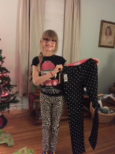 Abby holding up her new pants