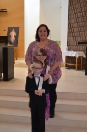 Shalaine with Abby and Aiden at the altar