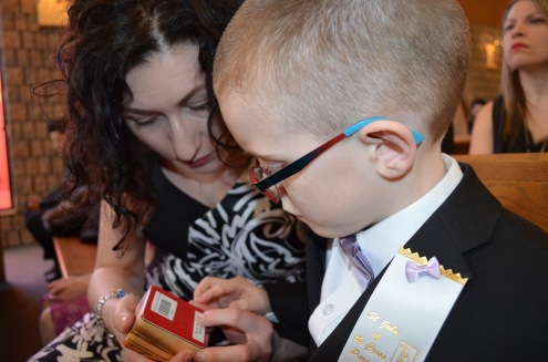 Mom showing Aiden the box that contained his rosary.
