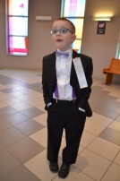Aiden relaxing in his suit after the ceremony.
