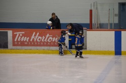 Dad giving Aiden some water in between periods