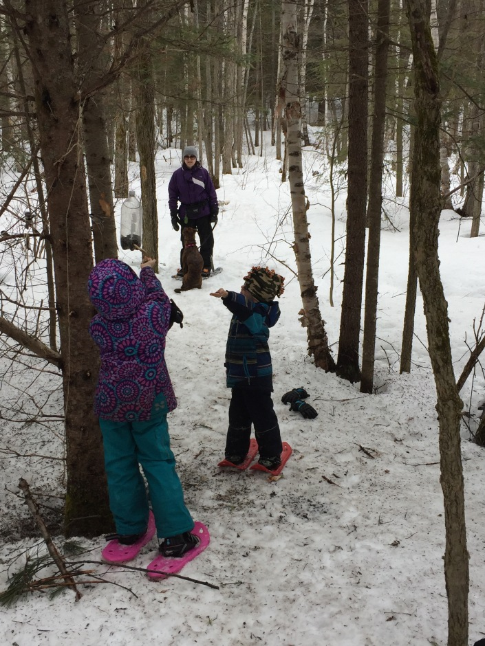 Abby and Aiden feeding the birds on the snowshoe trails