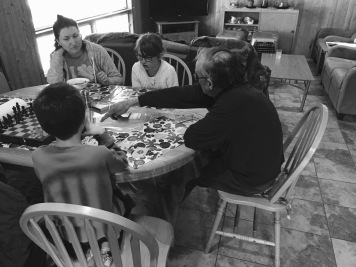 Uncle Al teaching Abby and Aiden how to play a new card game