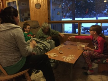 Auntie Joyce playing Crazy 8s with Abby, Aiden and Melissa