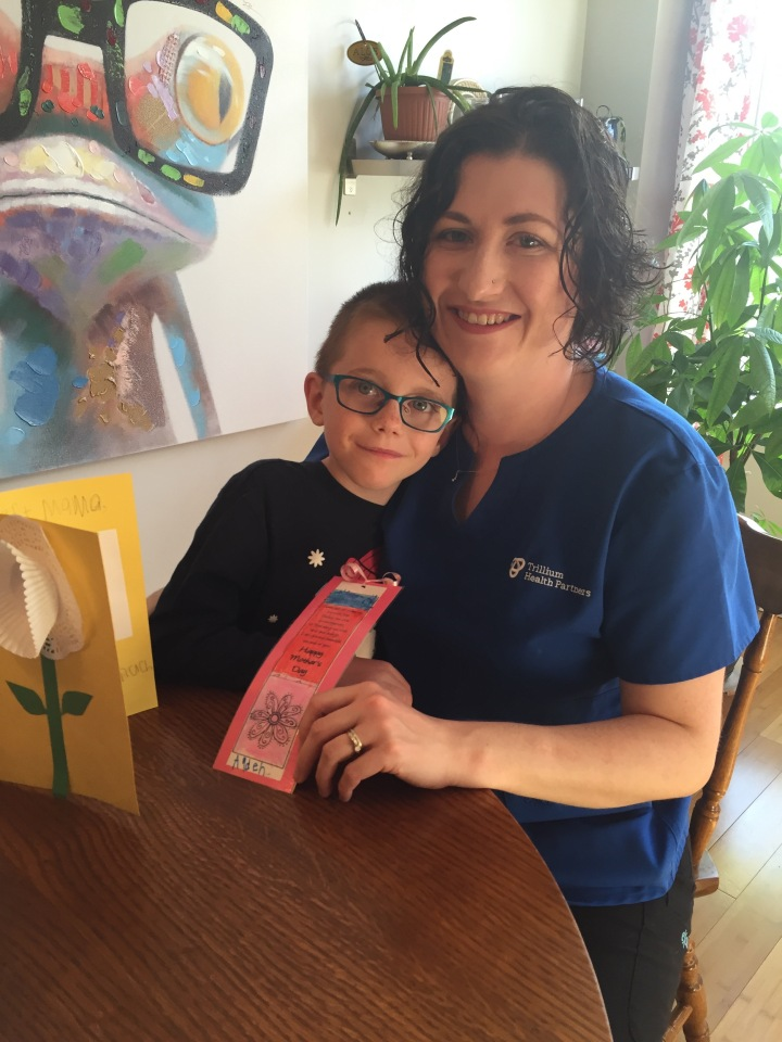 Melissa with Aiden and his card