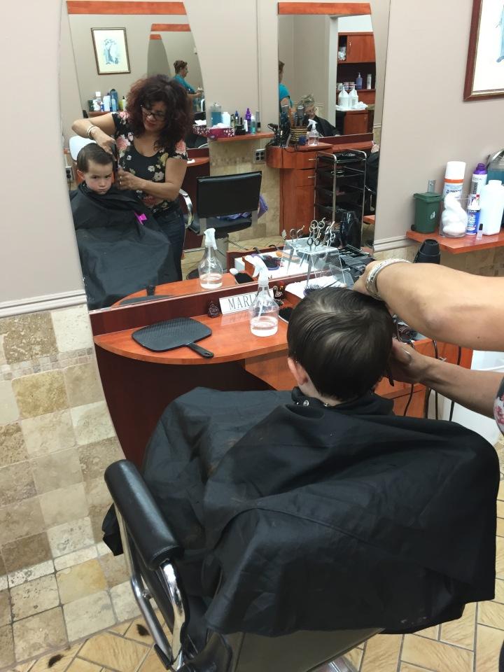 Macmillan getting his hair cut