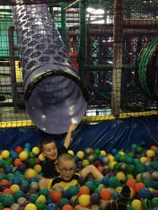 Macklan sliding into ball pit after Aiden