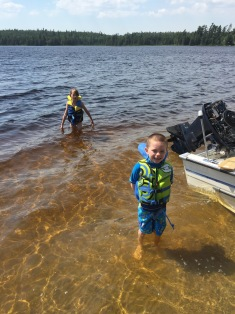 Aiden & Abby swimming in Marten River beside Aaron's new boat