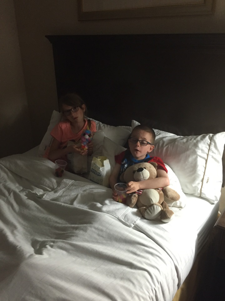 Aiden & Abby with treats in bed watching Star Wars