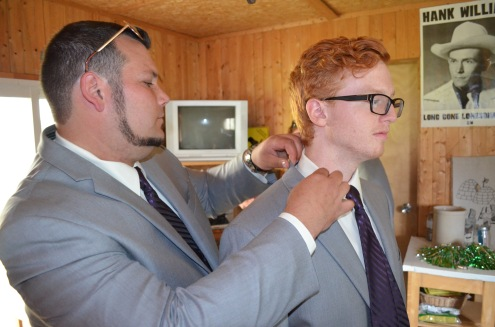 Patrick adjusting Lucas's tie