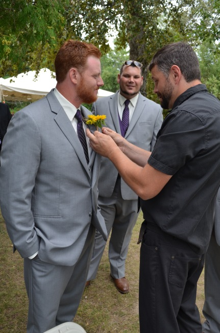 Uncle Luc putting corsage on Philip's suit.