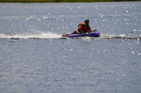 Abby tubing with Uncle Luc