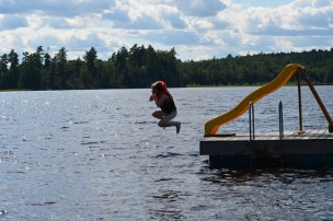 Abby jumping off the dock