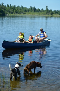 Peter, Abby & Aiden going for a canoe ride with Marley & Lind looking on