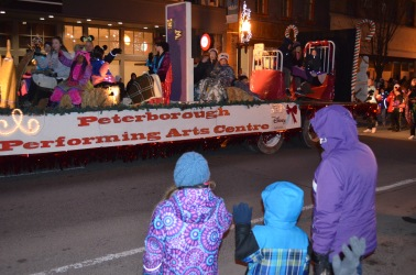 Melissa, Abby & Aiden watching a float go by