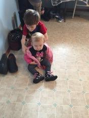Aiden helping his cousin Eva get ready to go