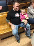 Uncle Jason holding Eva at the bowling alley
