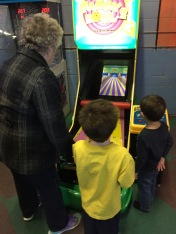 Mama playing arcade bowling with Aiden & Macklan