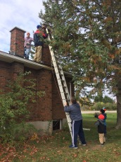 Peter, Rob, & Jason cleaning the Chimney with Macklan & Aiden supervising