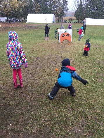 Aiden & Abby bowling pumpkins @ the Pumpkin Farm