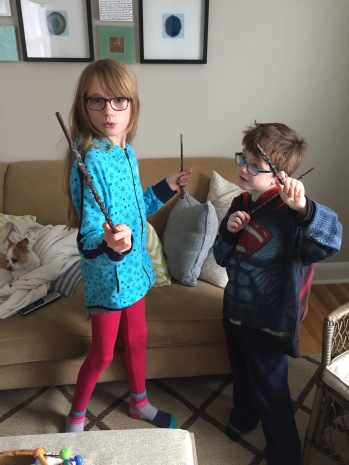 Abby & Aiden with their new wands that Auntie Megan made for them
